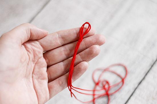 красная нитка от папиллом